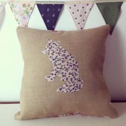 Appliqued, handmade, floral fox cushion on hessian background